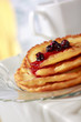 Pile of pancakes with fruit sauce