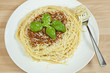 Spaghetti Bolognese With Basil Garnish and Grated Parmesan Chees