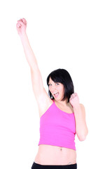 young healthy girl in pink celebrates a victory.