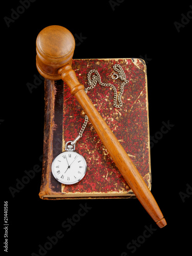 Judge's gavel and very old legal book with watch isolated