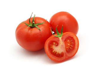 Three isolated tomatoes