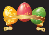 Three Easter eggs with ribbon.