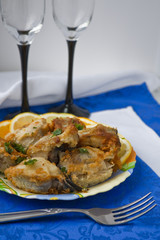 The plate with pieces of the fried fish