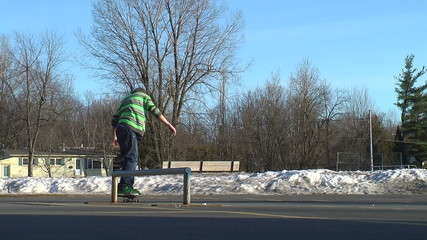Skateboarder doing grind on rail