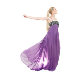 studio shot of beautiful woman in long purple dress