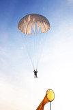 Skydiver falls through the air. Parachuting is fun!