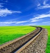 railway in a green grass