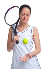 Woman tennis player throwing the ball up