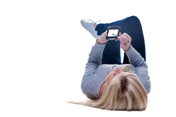 Woman lying down writing on her pda isolated