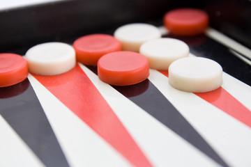 backgammon board with checkers