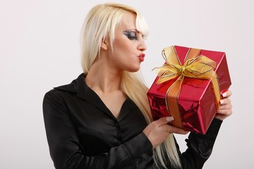 young woman with a present - a kiss