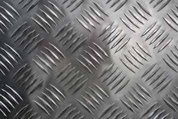 Detail of a new grid of steel placed along a road