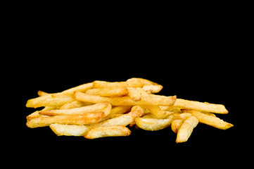 French fries against black