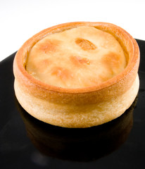 scotch mutton pie on black plate