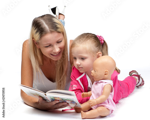 Mum reads the book to the daughter