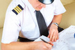 Airline pilot filling in papers in ARO