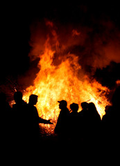 People at a bonfire