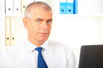 Businessman in office laptop