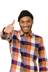 Mixed race youth making thumbs up sign, focus on face
