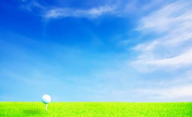 Golf ball on grass under blue sky with High-light processing
