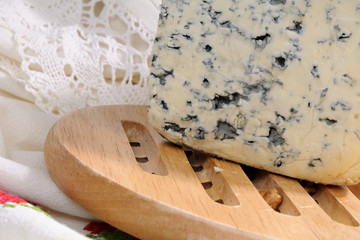 blue cheese textures isolated on wood