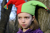 upset white child posing with funny hat poster