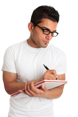 Student or man wearing glasses writing