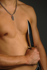man holding knife on a torso
