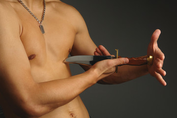 torso with knife on a black