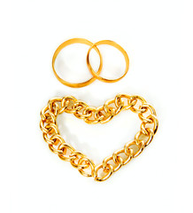 Gold rings and heart from gold chain