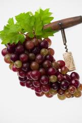 uvas y sacacorchos
