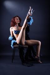 modern strip dancer in chair