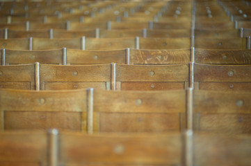 Plenty of wooden benches in the ancient church