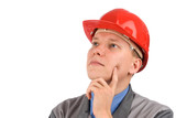 Portrait of a construction worker thinking in a hardhat