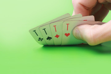 Playing poker in the casino with winning hand..