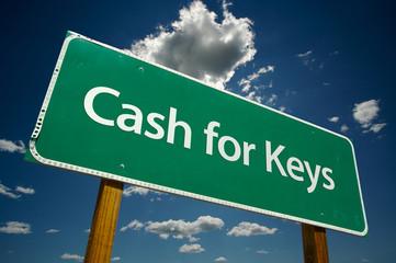Cash for Keys Green Road Sign Over Clouds