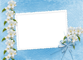 Blue abstract background with branch of Sakura
