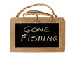 Fishing lure on top of gone fishing sign
