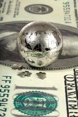 Dollar and globe.