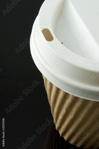 coffee cup container on black table