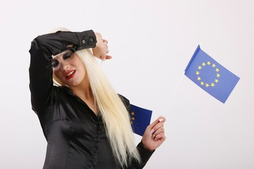 young woman with flags of European Union with reaction