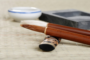macro asian calligraphy brush with accessories