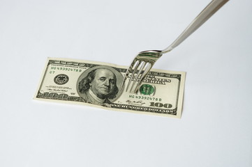 Fork and dollars.
