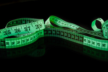 Measuring tape on a black background