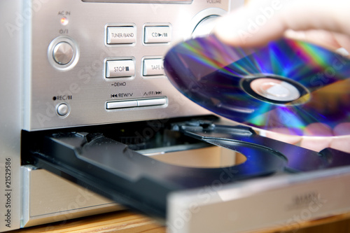Loading or putting CD into player