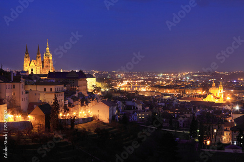 The panoramic View to bright Prague with colorful gothic Castle