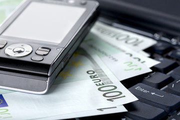 Office, business accessories and euro banknotes