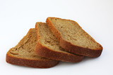 Whole wheat loaf of bread sliced in three pieces