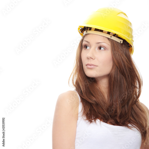 Engineer woman in yellow helmet