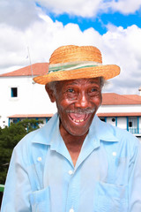 Old cuban man with straw hat make a funny face